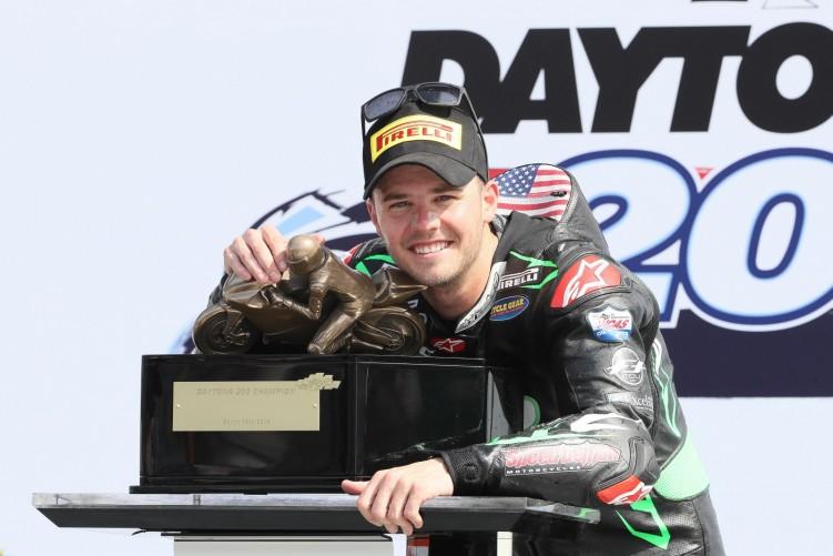 kyle wyman on the podium