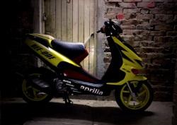 Aprilia SR50 alone in the dark